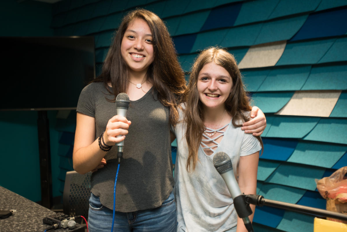 girls with microphones